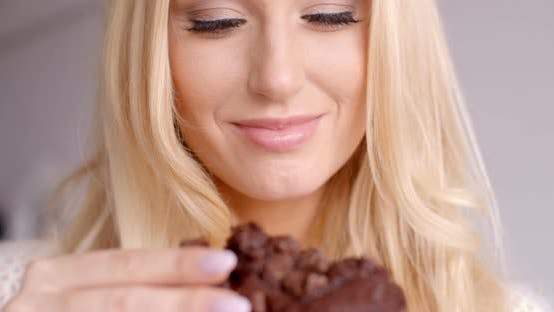 Thumbnail for Female Hand Holding A Piece Of Chocolate Cupcake 1
