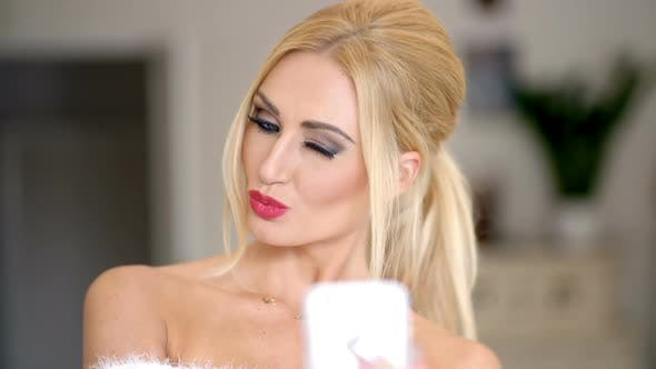 Thumbnail for Sexy Attractive Blond Woman Posing For A Selfie 2