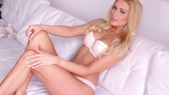 Thumbnail for Young Sexy Woman In White Bra And Panties On Sofa 2