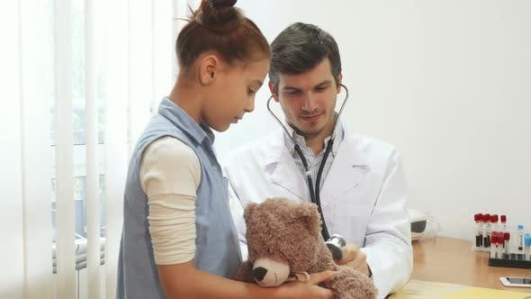 Cover Image for The Good Doctor Is Listening Through a Stethoscope Girl s Soft Toy