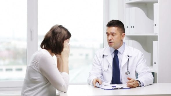 Thumbnail for Doctor And Young Woman Meeting At Hospital