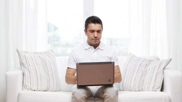 Thumbnail for Man Working With Laptop Computer At Home