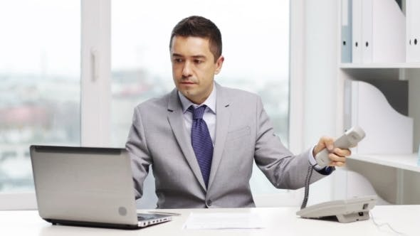 Thumbnail for Businessman With Laptop Calling On Phone