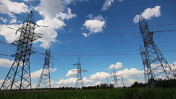 Thumbnail for Tall Electric Masts Against Cloudy Sky