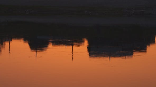 Cover Image for Reflected in the River in the Morning