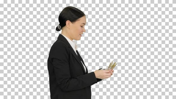 Thumbnail for Happy business woman counting money while walking, Alpha Channel