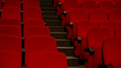 Empty Auditorium - Red Chairs In Rows