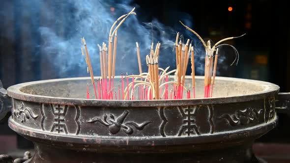 Thumbnail for Incense Sticks Burning In Giant Pot In Front Of Buddhist Temple