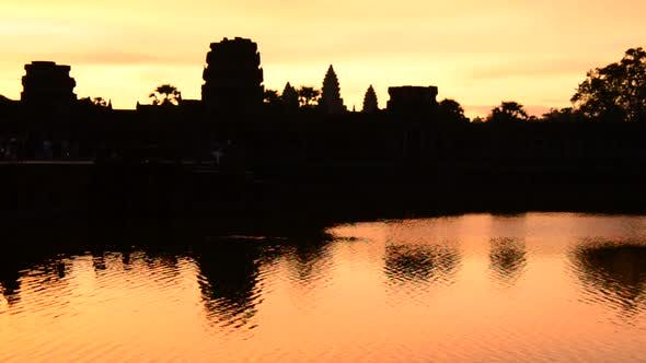Silhouette Of The Main Temple Buildings With Lake Reflection At Sunrise