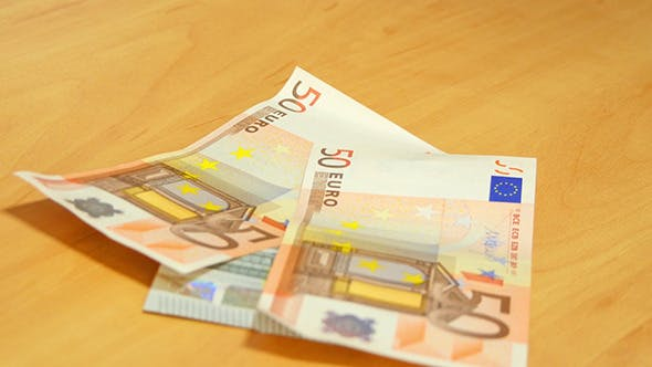 Thumbnail for Euro Banknotes Fall On The Table