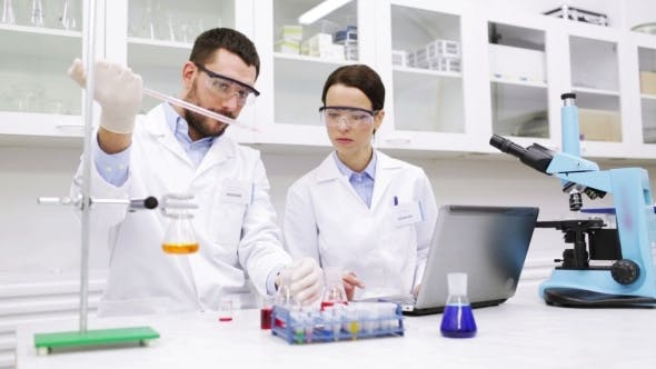 Thumbnail for Young Scientists Making Test Or Research In Lab