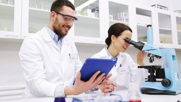 Thumbnail for Scientists With Tablet Pc And Microscope In Lab