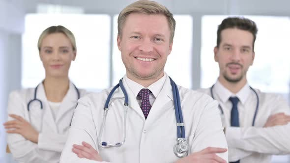 Portrait of Team of Doctors Standing with Arms Crossed