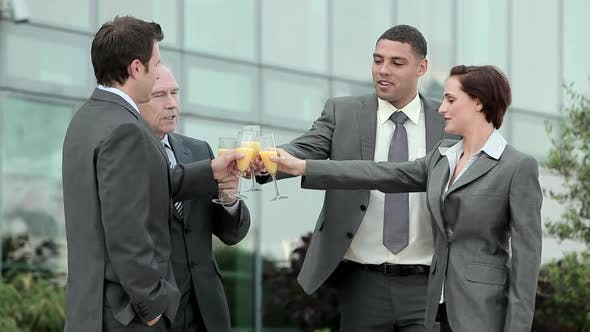 Thumbnail for Businesspeople outdoors, toasting with bucks fizz