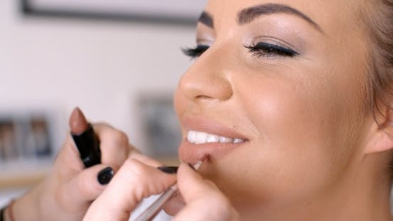 Thumbnail for Makeup Artist Applying Lipstick To Pretty Woman