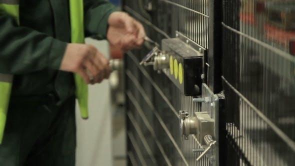 Thumbnail for Worker Opening Security Door