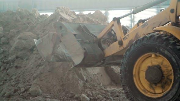 Bulldozer In Warehouse