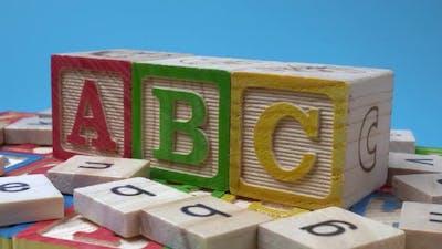 ABC wood block rotate on table.