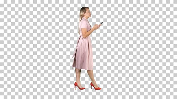 Thumbnail for Pretty blonde woman using cell phone texting message, Alpha Channel
