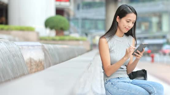 Cover Image for Woman using smart phone at outdoor