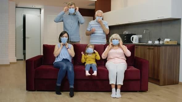 Thumbnail for Coronavirus Quarantine Lockdown Concept. Family Puts Medical Protective Masks on Faces at Home
