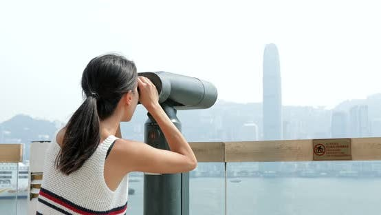 Thumbnail for Traveler viewing tourist binocular in Hong Kong city