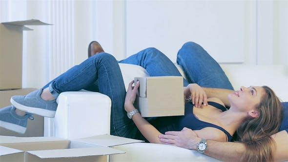 Thumbnail for Couple In Love Lying Among The Boxes
