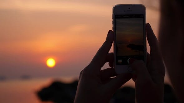 Thumbnail for Woman Taking Pictures With Smartphone At Sunset