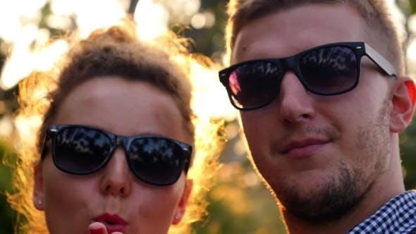 Thumbnail for Close Up Fashion Pretty Young Couple In Sunglasses