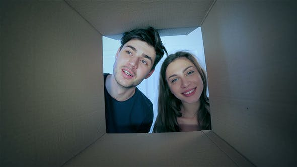 Thumbnail for Smiling Man And Woman In Love Look Into Boxes
