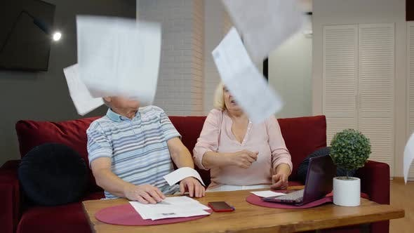 Thumbnail for Senior Couple Checking Papers, Domestic Bills, Planning Budget Investment Loan Insurance Payment