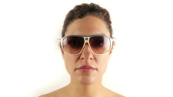 Cover Image for Stopmotion Of A Pretty Woman Wearing Different Retro Sunglasses 2