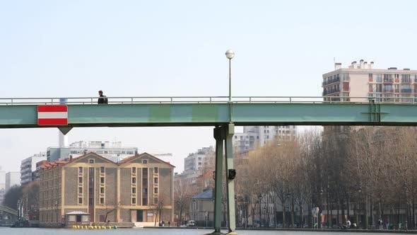 Thumbnail for Timelapse Of People Walking Across Footbridge In Paris 3