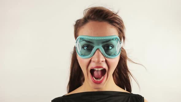 Cover Image for Woman Wearing Retro Goggles Making Faces 1