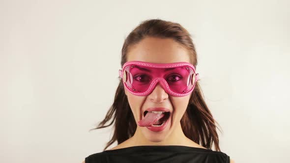 Thumbnail for Woman Wearing Retro Goggles Making Faces 2