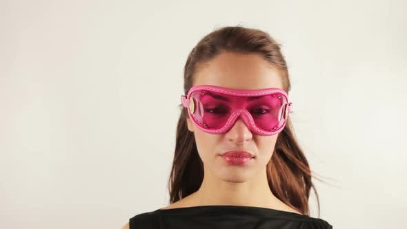 Thumbnail for Woman Wearing Retro Goggles Making Faces 3