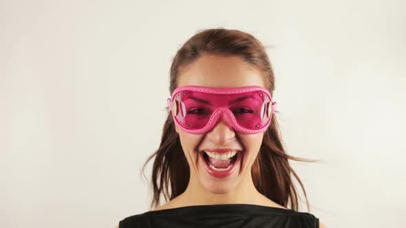 Cover Image for Woman Wearing Retro Goggles Making Faces 4