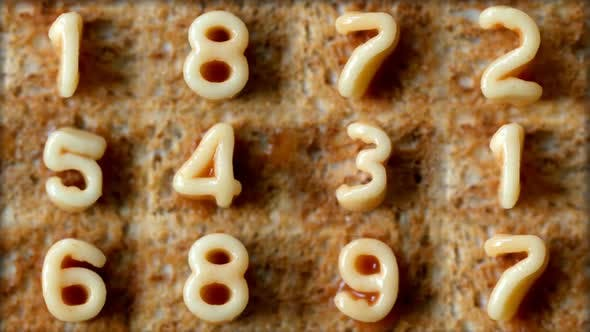 Thumbnail for Number Sequence Made From Spaghetti Pasta Letters In Tomato Sauce On Toast 5