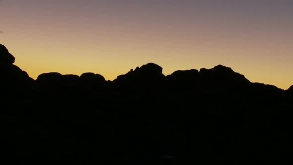 Thumbnail for Sunset Fading Over Rocks - Clip 1