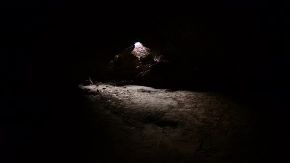 Thumbnail for Light Rays Shine Inside Of Lava Tube Cave