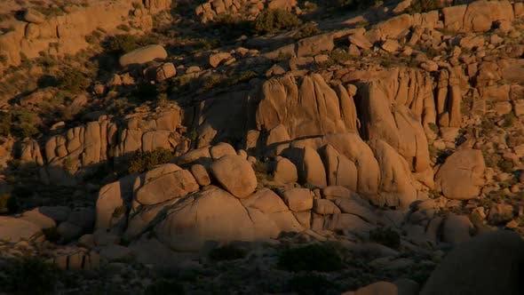 Thumbnail for Desert Rocks  Sunset Shadows Creep Along Rocks - 2
