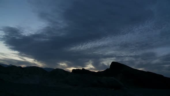 Cover Image for Clouds Over Desert Rocks