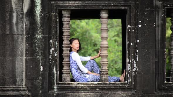 Thumbnail for Female Buddhist Meditating In Temple Window - Angkor Wat, Cambodia 1