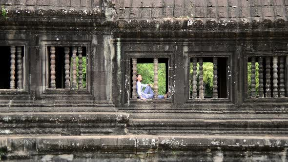 Thumbnail for Female Buddhist Meditating In Temple Window - Angkor Wat, Cambodia 2