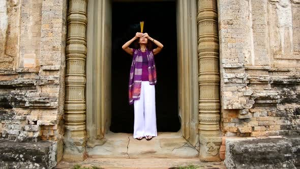 Cover Image for Female Buddhist Praying With Incense In Temple Doorway -   Angkor Wat Temple Cambodia 4