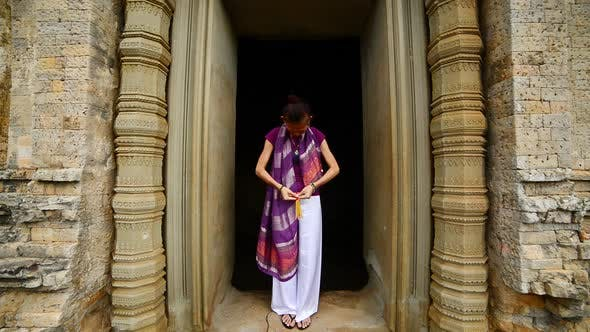 Thumbnail for Female Buddhist Praying With Incense In Temple Doorway -   Angkor Wat Temple Cambodia 5