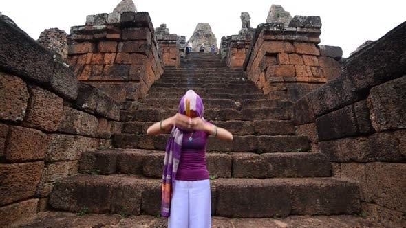 Thumbnail for Female Buddhist Slowly Walking Down Temple Steps With Incense -  Angkor Wat Temple Cambodia 1