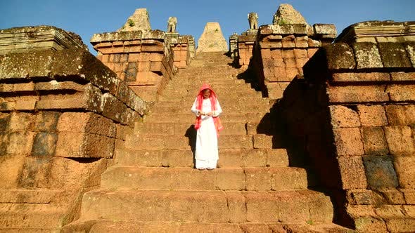 Thumbnail for Female Buddhist Slowly Walking Down Temple Steps With Incense -  Angkor Wat Temple Cambodia 2