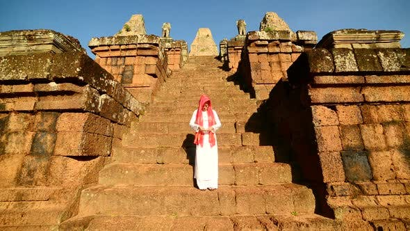Thumbnail for Female Buddhist Slowly Walking Down Temple Steps With Incense -  Angkor Wat Temple Cambodia 3