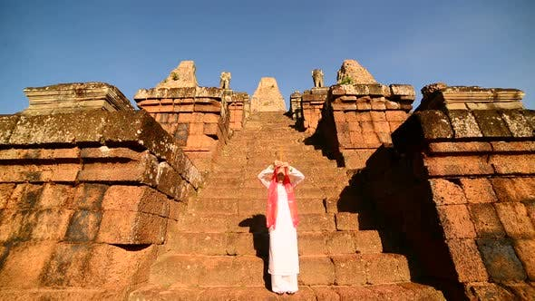 Thumbnail for Female Buddhist Slowly Walking Down Temple Steps With Incense -  Angkor Wat Temple Cambodia 4